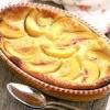 Як приготувати пиріг з мигдалем і персиками?